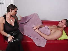 Big breasted German MILF gagging on a hard cock
