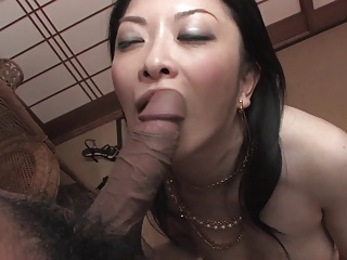 Japanese whore shoves two dicks in her mouth during gangbang